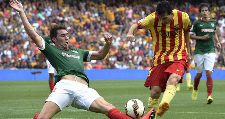 Laporte y Leo Messi en un Barça - Athletic Club / EFE